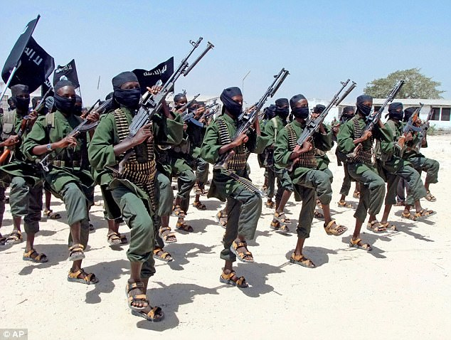 Al-Shibab extremists are pictured in Somalia. The UK's aid to the most corrupt states on the planet has risen by 10 per cent
