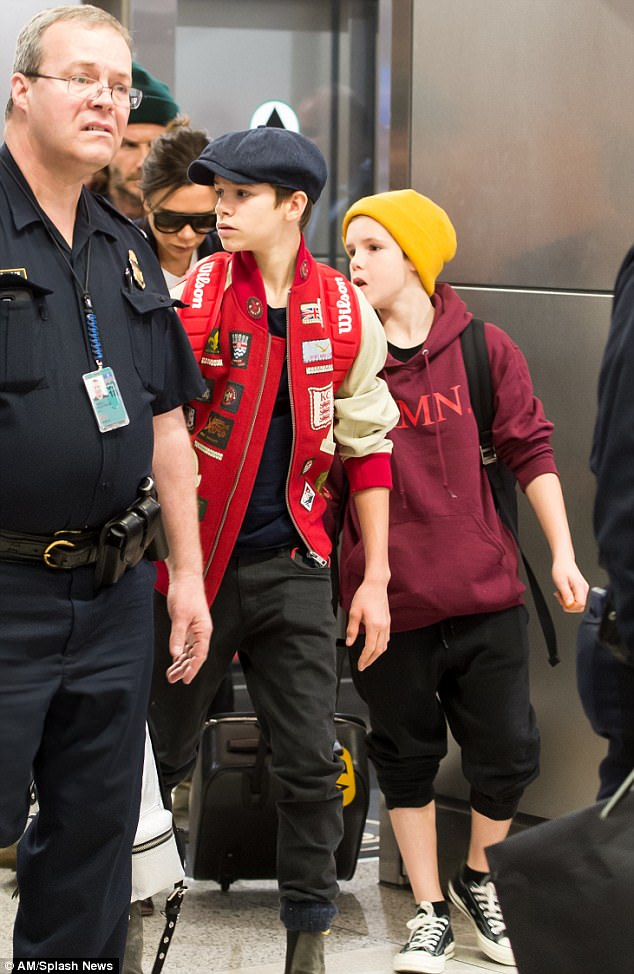 Like father, like son: Cruz emulated his Dad, as he also sported a beanie which he paired with a burgundy hoodie and cropped black trousers