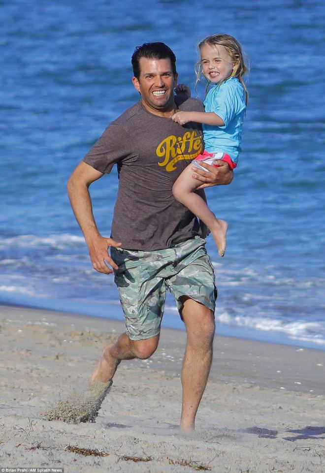 Donald Trump Jr. celebrates New Years Eve and his 40th birthday with his children as he runs in the sand and plays football with guests at Mar-A-Lago in West Palm Beach