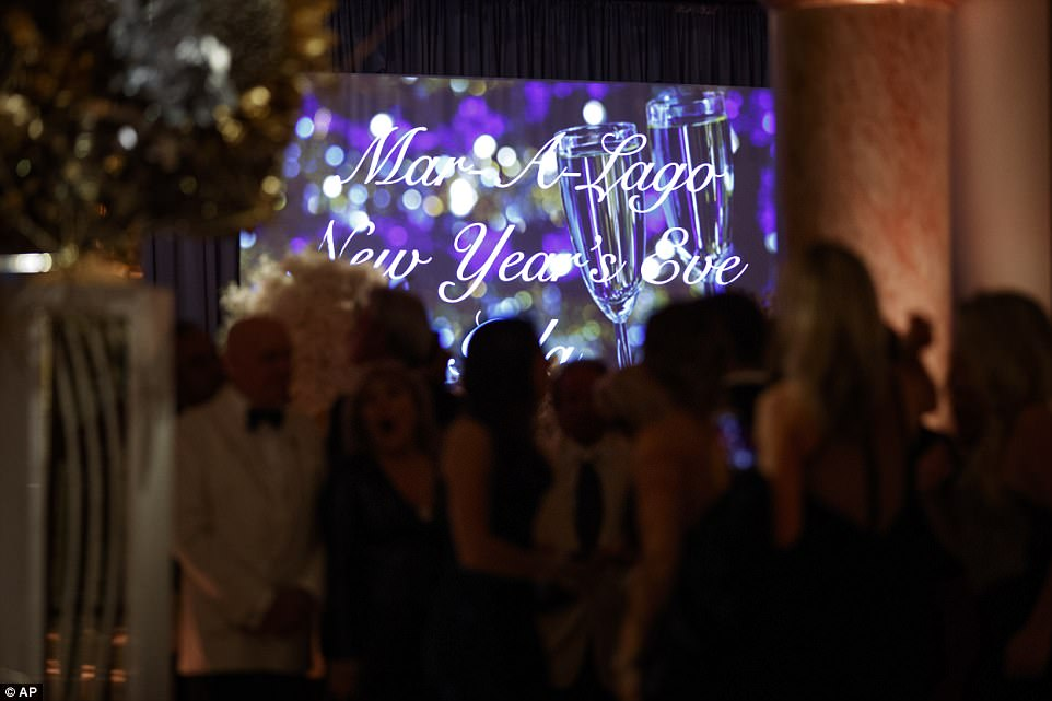 An interior view of the ballroom is shown as guest gather together to chat and celebrate the coming New Year