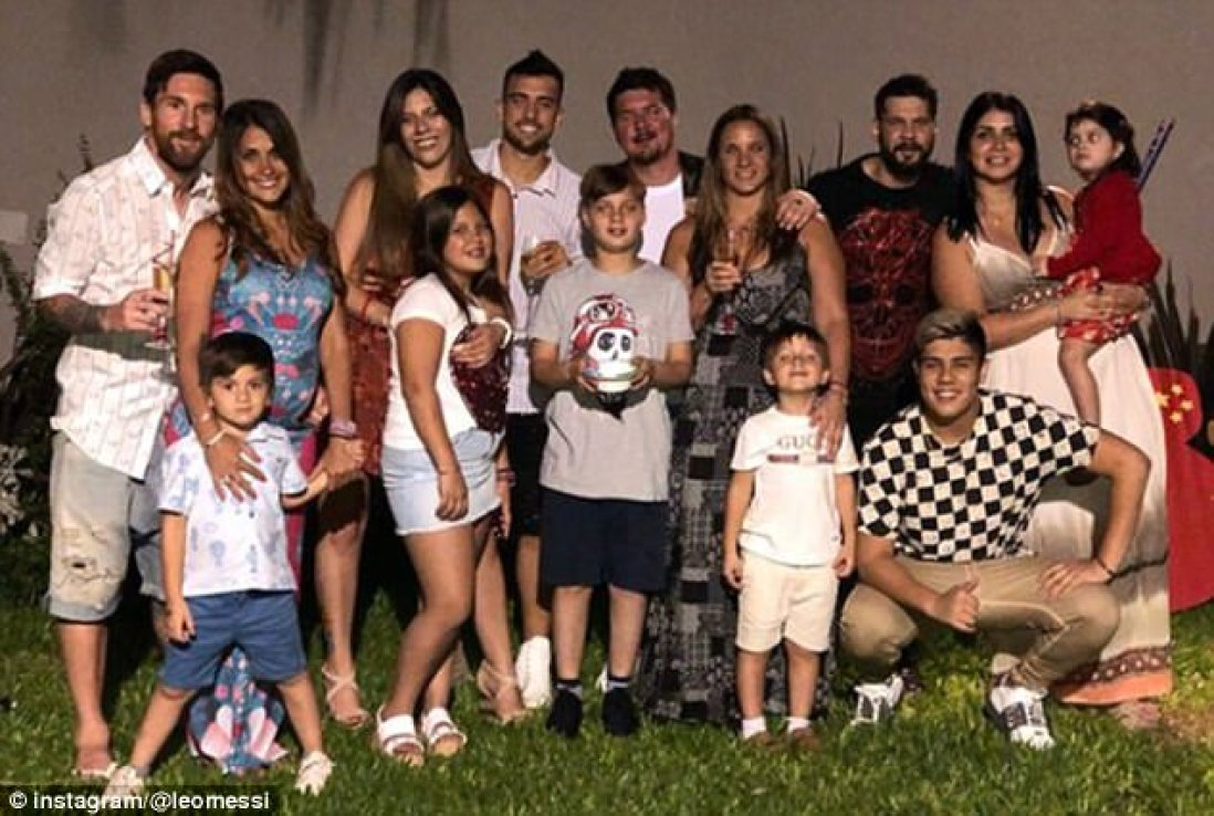 LionelMessi (left) posed with family and wife Antonella Roccuzzo - who he married in June