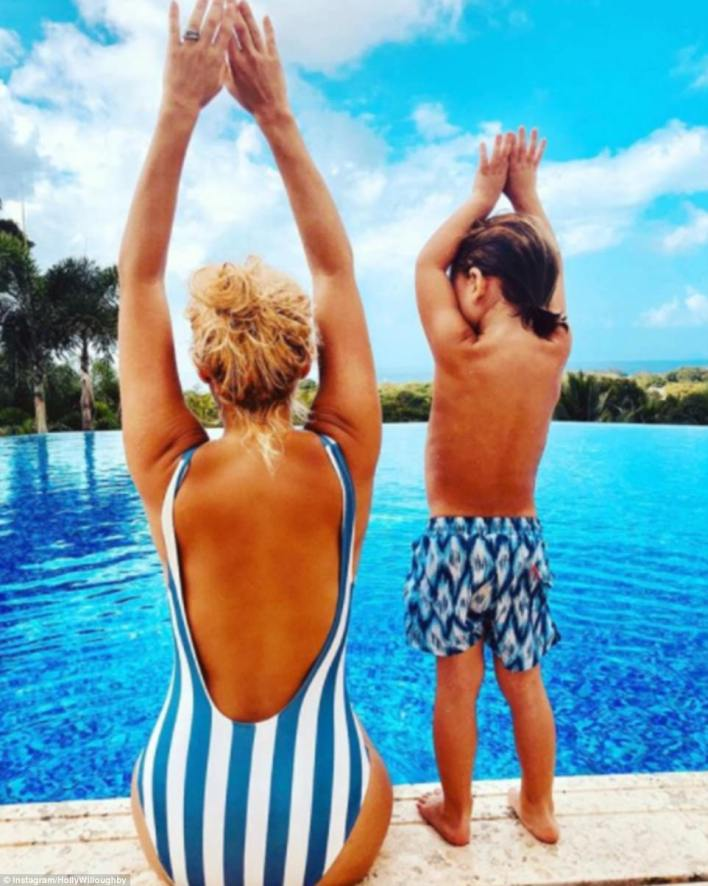 Sensational: She shared a sweet snap of herself teaching her three-year-old son Chester how to dive from the edge of the pool earlier in the day
