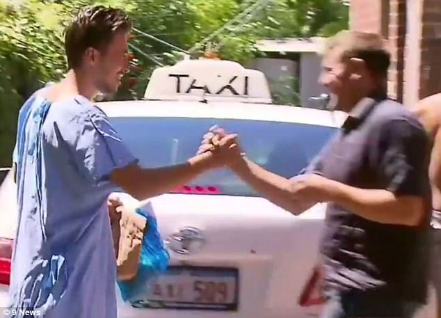 One of the men involved in the suspected overdose shakes hands with his taxi driver as he arrives back at the Perth house