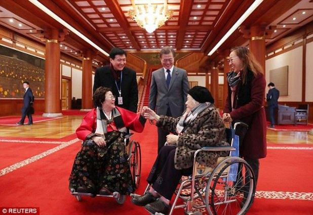 "South Korean President Moon Jae-in greets South Korean girls folk who were pressured to work in Jap wartime brothels as ""comfort girls folk"", on the Presidential Blue House in Seoul"