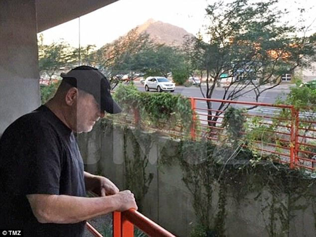 Things are looking down: Harvey Weinstein (above) was photographed on Thursday afternoon in Arizona, standing on the edge of what looked to be a parking garage