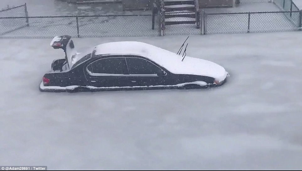 One amateur video filmed in Revere, Massachusetts, the coastal city just north of Boston, showed a large sheet of ice covering the street