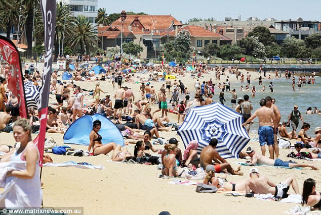 People have flocked to the beach to make the most of the warm weather in Melbourne