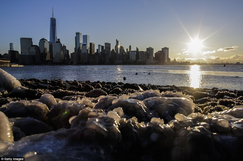 Ice floats along the Hudson River as the skyline of New York City and One world Trade Center are seen during freeze temperatures on January 06, 2018