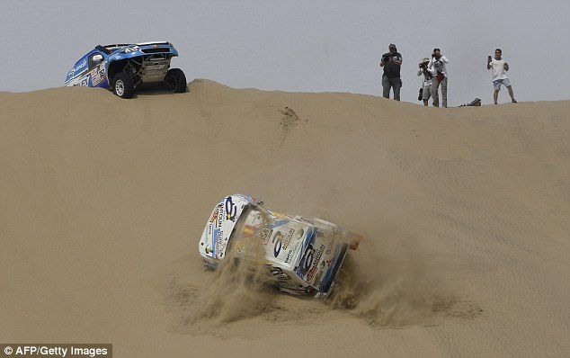 Cristina Gutierrez Herrero gets into trouble as her Mitsubishi takes a tumble down a hill