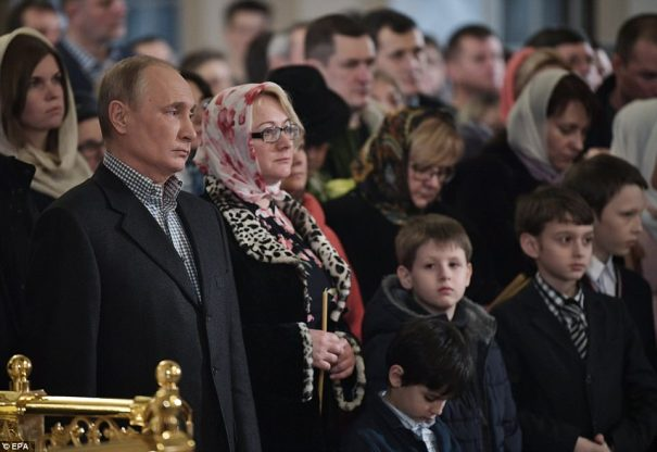 Russian President Vladimir Putin attended a Mass at the Church of Sts. Simeon and Anna in St. Petersburg, his hometown