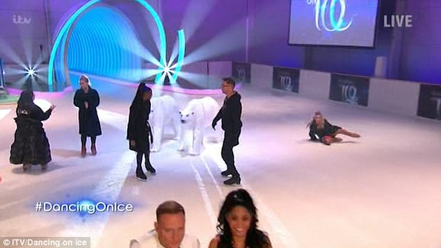 Oops: She was caught on camera during as cameras panned over the contestants warming up