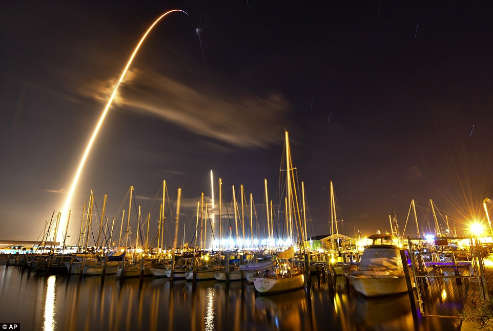 A top secret billion-dollar spy satellite plummeted into the Indian Ocean after a botched SpaceX mission over the weekend, but Elon Musk's company has insisted they are not to blame. In this image made with an 8-minute long exposure, the SpaceX Falcon 9 rocket launches from Cape Canaveral and lands as seen from from the Ocean Club Marina in Port Canaveral