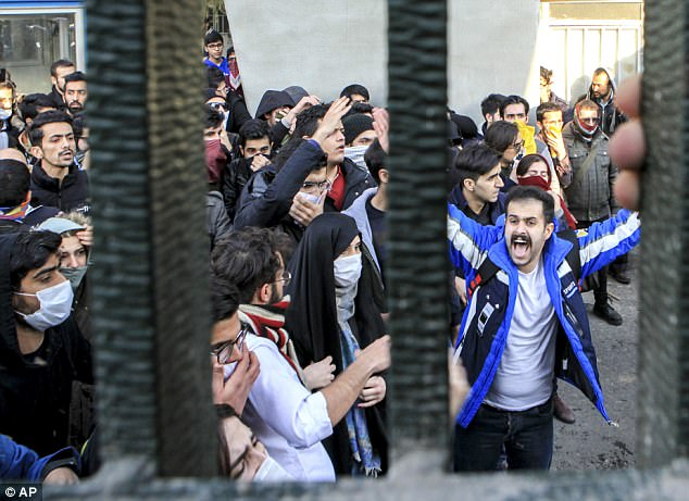 In contrast: University students attend an anti-government protest inside Tehran University, in Tehran, Iran last month