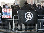 Five men and a woman have appeared in court over allegations they were members of banned far-right group National Action. Pictured: File photo of the group's protest in Bolton in 2016