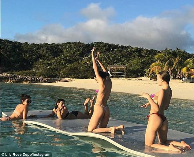 Baring all: Lily Rose Depp proved she certainly isn't shy as she shared a topless snap from her holiday with friends to Instagram on Tuesday