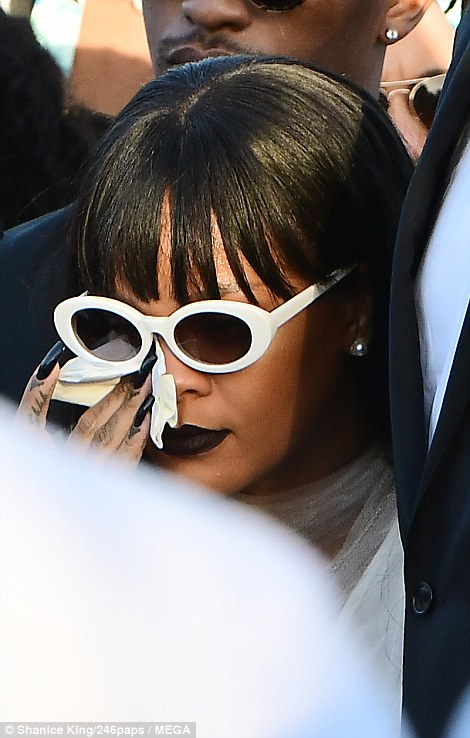 Tough: Rihanna had tears rolling down her eyes during the ceremony