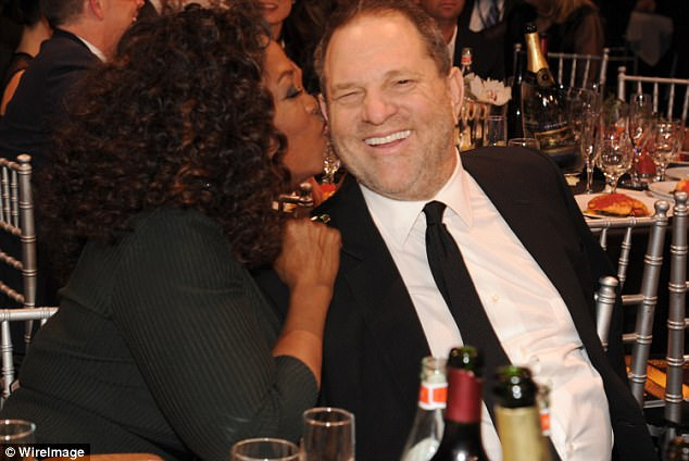 Chummy: Oprah and Harvey Weinstein at the 19th Annual Critics' Choice Movie Awards at Barker Hangar on January, 2014 in Santa Monica, California