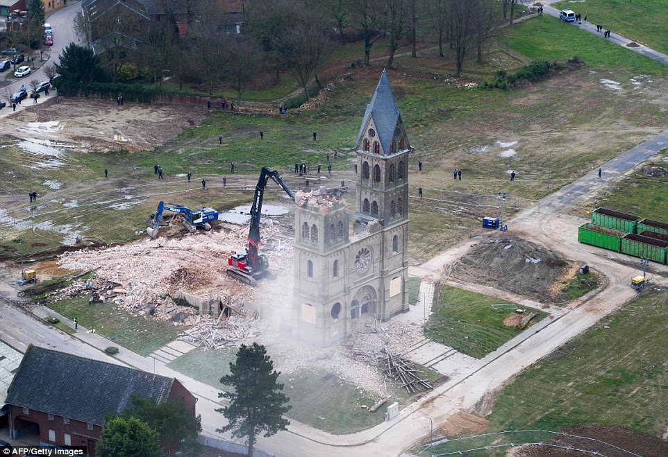 St Lambertus Church (pictured) was torn down by RWE Power to make way for coal mines despite protests from Greenpeace
