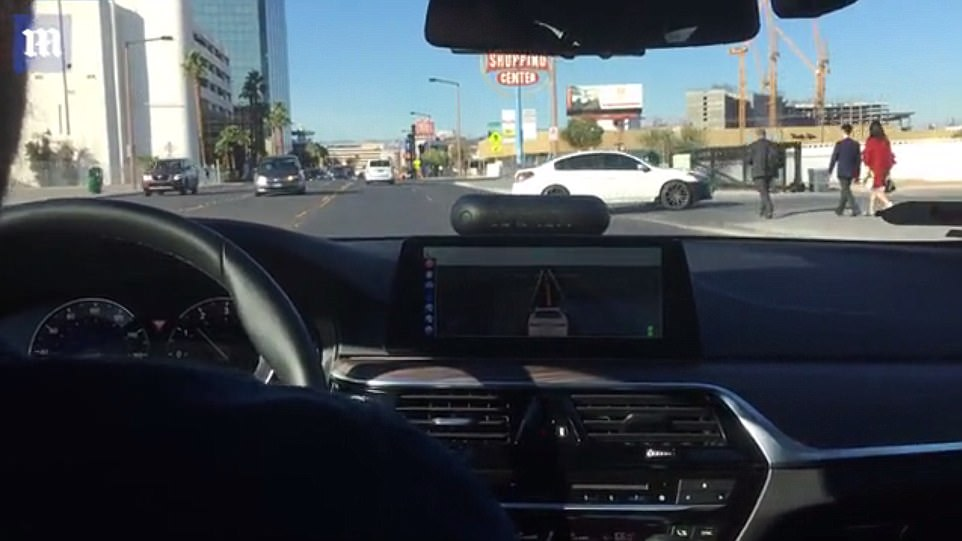 As the autonomous car made its way down a straight road, another vehicle in the on-coming lane decided to make a last-minute left turn into a parking lot