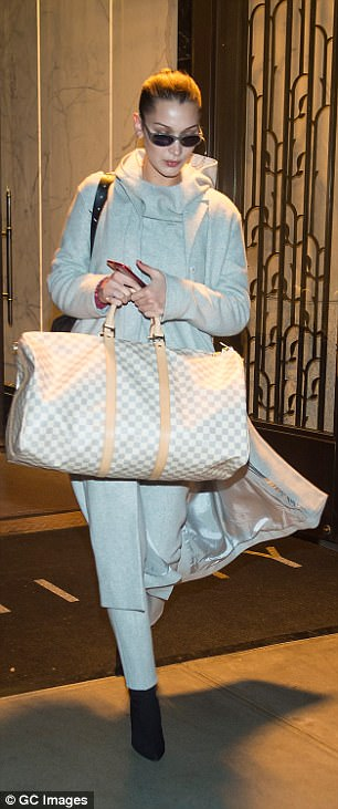 Not travelling light: She appeared destined for a long stay, carrying two large bags with her