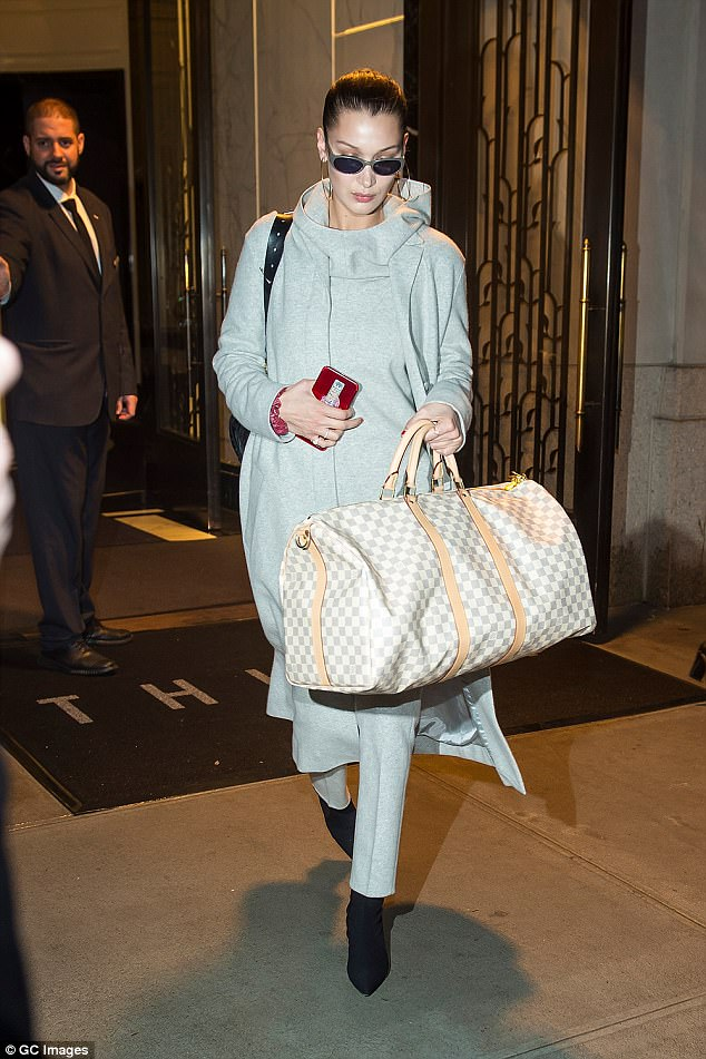 Quick change: Later Bella slipped into this all-grey ensemble