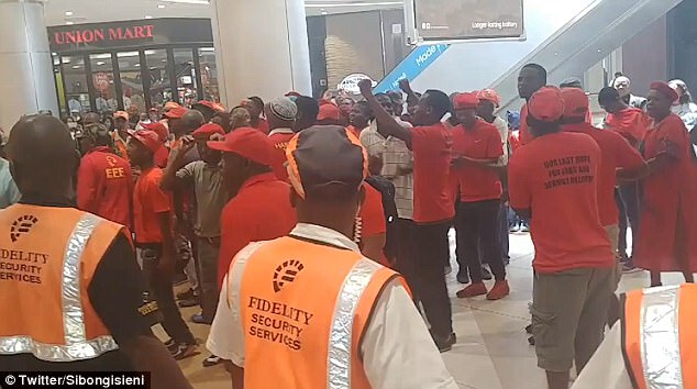Members of the Economic Freedom Fighters staged a protest outside an H&M store at the Sandton mall in South Africa