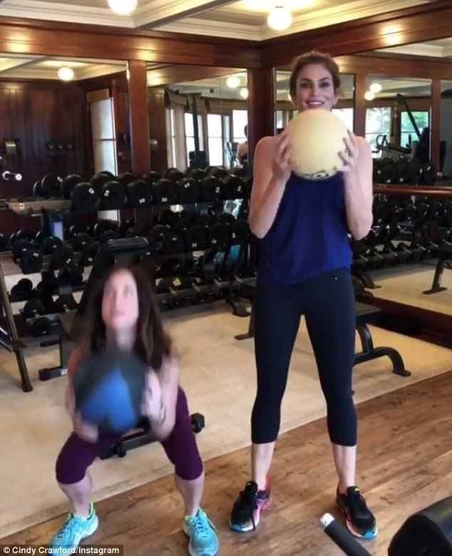 Getting fit!Cindy Crawford proved she was still in top-notch shape as she shared a video of herself working out with her personal trainer, Sarah Haganan, at the gym