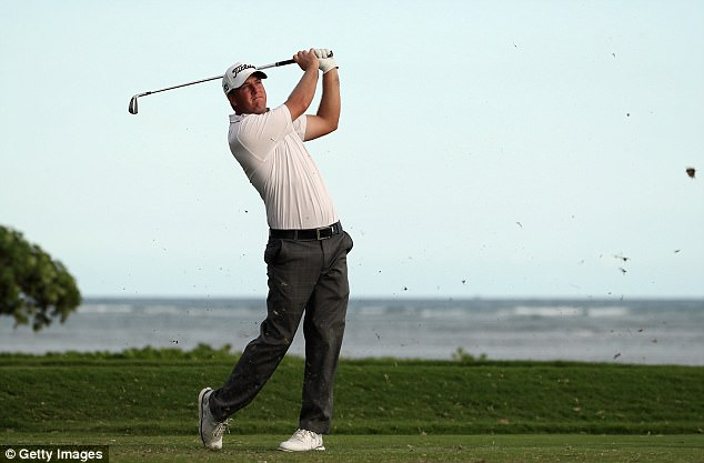 Tom Hoge kept his cool despite off-course distractions to top the Sony Open leaderboard