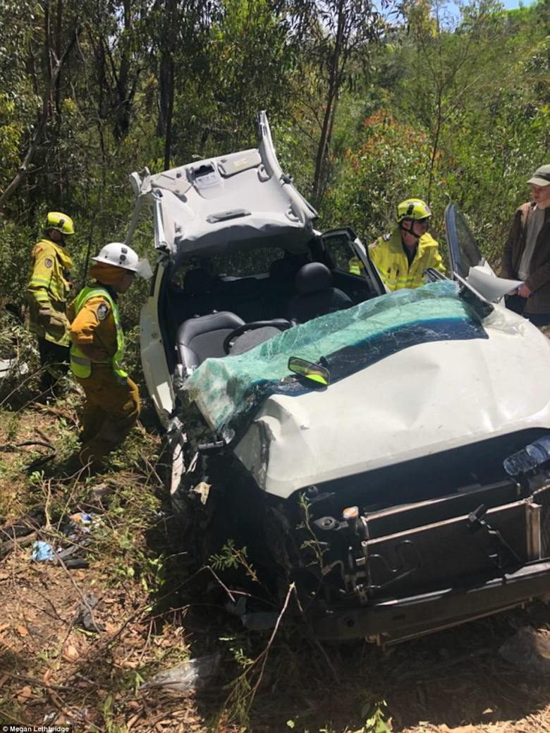 NSW Fire and Rescue officers at Sam Lethbridge's vehicle after the 17-year-old was cut free late on Monday morning