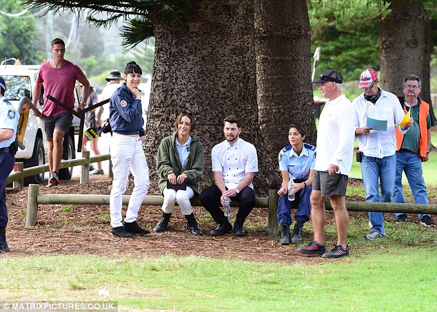 The actor is seen here centre filming with Jessica (far left) and Pia Miller (far right)