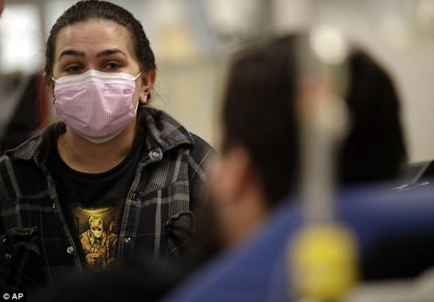 The Loma Linda University Medical Center in San Bernardino County and the Palomar Escondido Medical Center in North County San Diego are just two of the hospitals that have set up tents, and Torrey Jewett (left) appears in the picture. look at his roommate Donnie Cárdenas (right) who is recovering from the flu at Palomar Medical Center