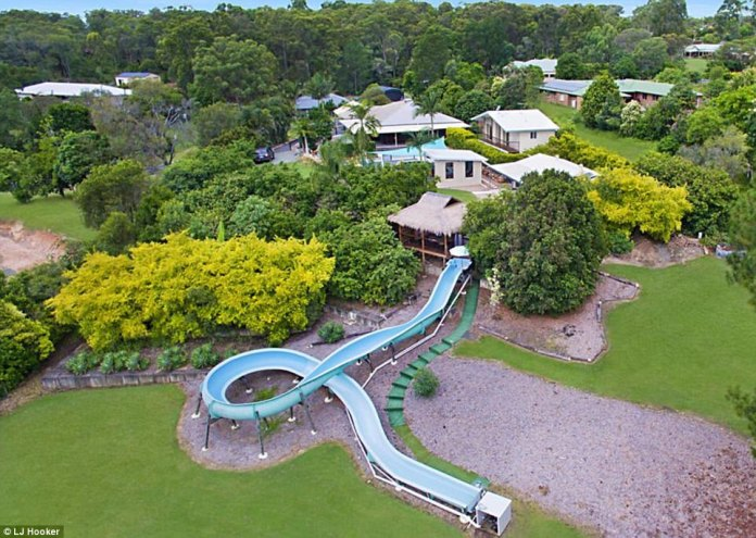A Brisbane home featuring an amazing 50-metre water slide is up for sale (pictured), turning heads of potential buyers