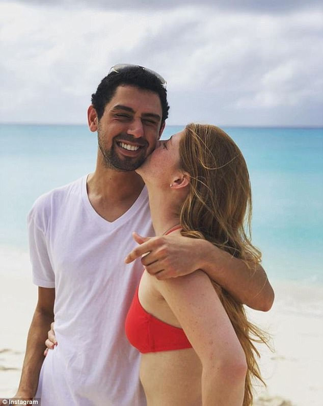 Jennifer sweetly kissed boyfriend Nayel Nassar on the cheek in the photo, as the two stood in front of a stunning background of white sand, blue water and puffy, white clouds, while celebrating their one year anniversary