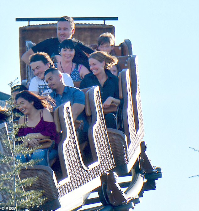 Look out below:  While the young boys were likely to steer clear from the scarier rides, Lara did enjoy a session on a roller coaster while Sam and her children watched on from below