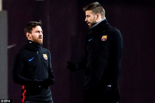 Lionel Messi (left) chats with team-mate Gerard Pique during a training session on Saturday