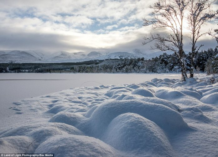 Loch Morlich looks like a winter wonderland after snowed blanketed the area at the foot of the Cairngorms in Scotland