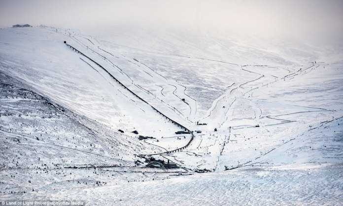 The Cairngorm ski resort in the Scottish Highlands benefits from the wintry conditions with a fresh layer of snow this morning