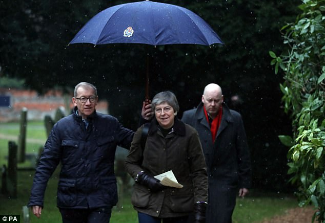 Theresa May (pictured today heading to church in Maidenhead with her husband Philip)has said she wants Britain to get a bespoke trade deal with the European Union.
