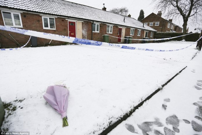 Floral tributes started arriving and were placed on top of the snow in front of the house which was cordoned off by police officers
