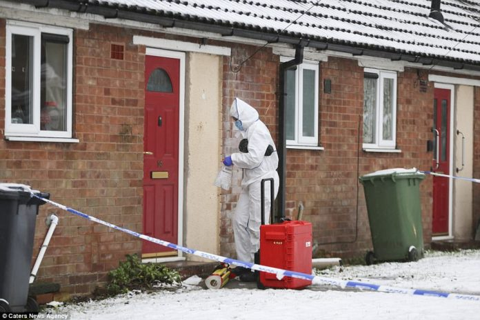 Forensics enter the property at Valley Views in Birmingham on Sunday after an eight-year-old girl was stabbed to death in a domestic incident