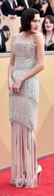 Strike a pose:The 29-year-old actress looked like a classic movie star on the red carpet, arriving in a beaded white and silver Ralph & Russo gown with red lipstick