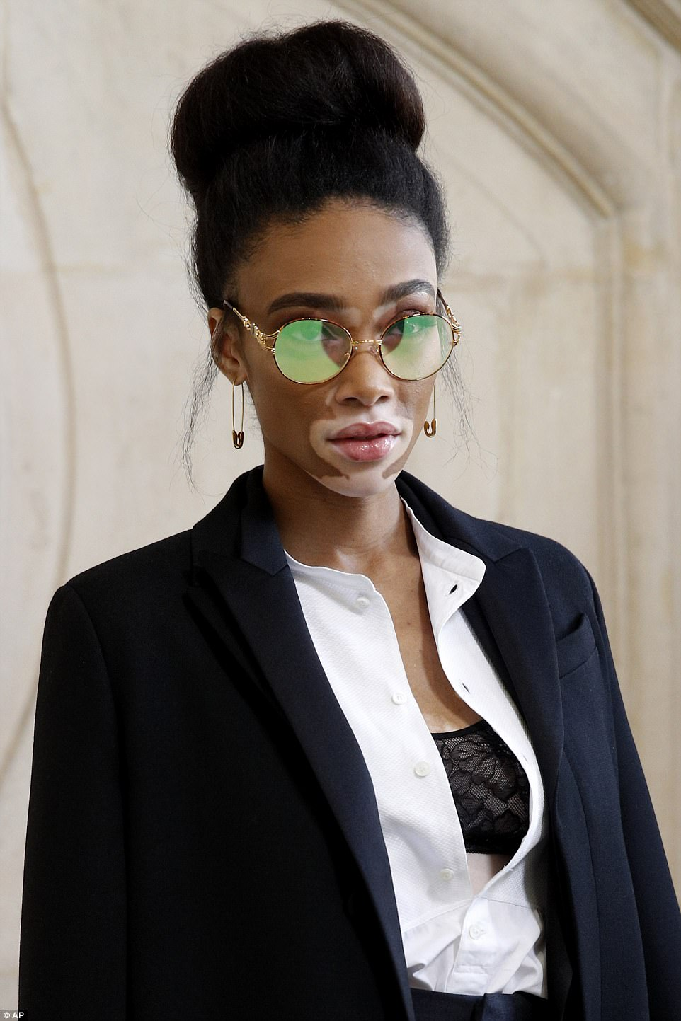 Touch of quirkiness: Winnie kept with the gold theme with her safety-pin style earrings and kooky vintage sunnies, while the rest of her locks were piled into an immaculate bun