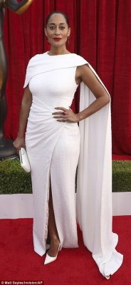 Dramatic choice: Both Tracee Ellis Ross (l) and Uzo Aduba (r) decided to go with a caped frock in all white