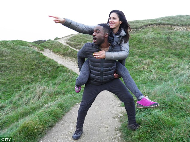 Julia presents Britain's Favourite Walks: Top 100 with 2016 Strictly winner Ore Oduba (pictured together on the South Downs in East Sussex)