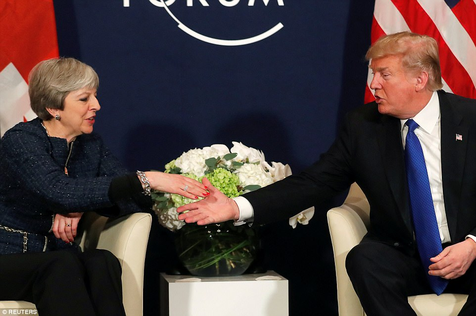 No hard feelings: U.S. President Donald Trump shakes hands with Theresa May during their meeting on Thursday in Davos