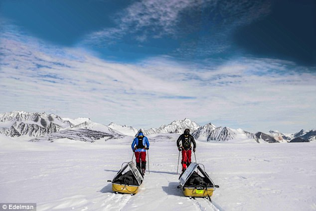 Robert and Barney Swan are pictured dragging their solar panel-clad sleds across Antarctica during their epic 57-day expedition