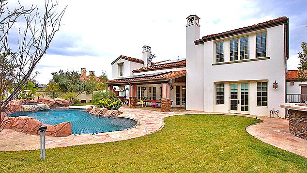 Beautiful building: According to TMZ , the expectant mum - who owned this property at the exclusive Hidden Hills gated community - is set to house her first child in a decadent mansion, with building permits suggesting the value of the job to be over $2.37m (£1.91m)