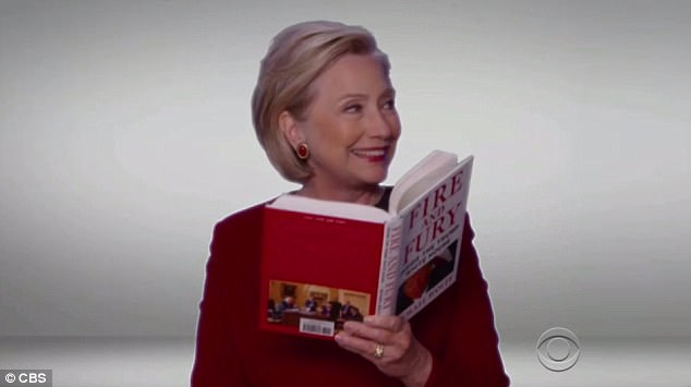 Happy Hil: In the segment at the Grammys (above), Clinton had a giant grin as she read a passage about President Trump's 'longtime fear of being poisoned'
