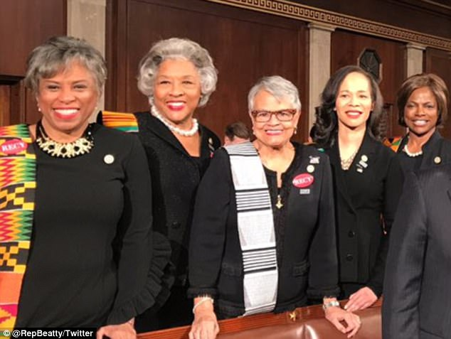 Democratic Reps. Brenda Lawrence, Joyce Beatty and Bonnie Watson Coleman are pictured Tuesday night standing in front of their seats in the House chamber at the U.S. Capitol