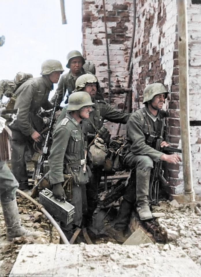 German soldiers carrying a MG 34 machine gun prepare to assault a Soviet position in Stalingrad. The can be seen wearing Stahlhelm - German for 'steel helmet'. These became standard issue during World War 1 when the Imperial German Army began to replace the traditional boiled leather Pickelhaube (spiked combat helmet) in 1916
